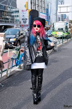 Guitar-toting Harajuku girl w/ Dip Dye Hair, Lots of Leather & Hello Kitty
