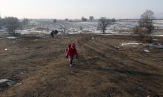 A migrant child walks from the Macedonian border into Serbia, near the village of Miratovac.