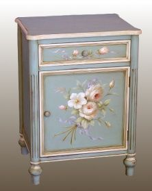 A beautiful wooden cabinet with an opening cupboard and a drawer. Perfect as a bedside cabinetFinsihed in blue with an exquisite floral design hand paintedThis item is ready assembled