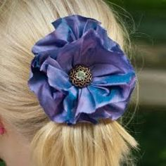 How to Make a Gathered Fabric Flower - It's easier than ever to make your own fabric flowers with this tutorial that teaches you How to Make a Gathered Fabric Flower. Make fabric flowers for your hair, your clothes, or just to have around the house!