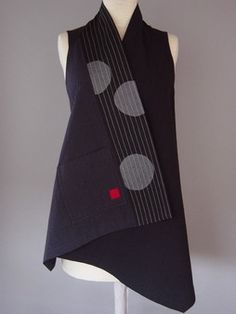 Wrapped Shoulder Vest in Black with Moon and Section. Black Japanese cotton with silk. All quilted. Juanita Girardin