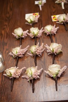The groomsmen boutonnieres will be a combination of blush pink spray roses and pale pink astilbe wrapped in thin black ribbon with the stems showing.