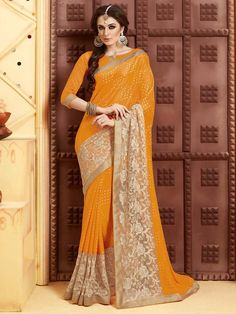 Yellow Bandhej Saree with resham and kundan work. Item Code: SSVH6669 http://www.bharatplaza.com/new-arrivals/sarees.html
