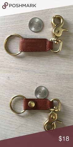 Small leather Coach key fob In perfect condition. Coin is shown for size purposes only. I accept offers but do not trade. Thanks for looking. Coach Accessories Key & Card Holders