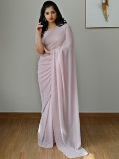 Check out the most elegant designer sarees for party and wedding ocassions by the brand Laksyah. Fancy Sarees Party Wear, Saree Designs Party Wear, Party Wear Sarees Online, Saree Blouse Patterns, Saree Blouse Designs, Saris, Sarees For Girls, Saree Poses, Simple Sarees