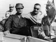 President Nasser and President Gaddafi are Sitting in a jeep and watching the manoeuvres while in front is Major-General Mohammed Fawzi, the Egyptian War Minister.