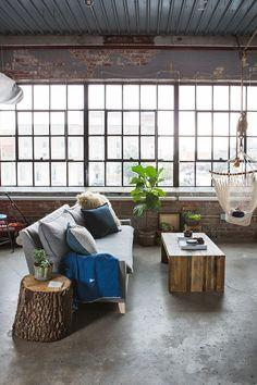 loft studio apartment, rustic, grey sofa, hammock swing chair // Chelsey Cobbs' Oklahoma City Studio Apartment Tour #theeverygirl