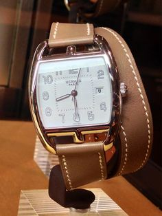 The new classics. Hermes updated Cape Cod watch called the Tonneau with a mink colored double tour strap.