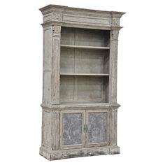 "Laurent Bookcase from Joss and Main. Pine wood bookcase with two removable shelves and two bottom doors. 90.5""H x 52""W x 19""D. $1812.95"