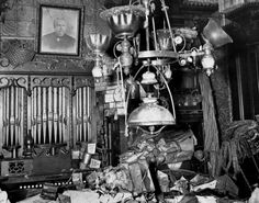 This is the Collyer family studio and music room complete with a pipe organ and a gaslight era chandelier.