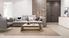couleur salon blanc beige et gris canapé droit rembourré et table basse en bois