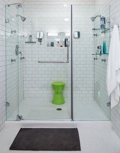 large shower, like the white subway tile, double shower heads, recessed shelf for shower supplies