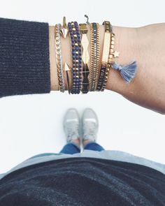 Multiple Grey Gold Bracelets