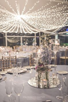 With a cascading Fairy Light Canopy, this elegant pastel watercolour wedding was sure to impress guests. Soft lilac hues draped the tables in smooth satin tablecloths, with powder blue satin napkins and silver beaded charger plates used to frame each guest place setting. Ambience was created on the table with silver mercury tealight votives and Limewash Tiffany Chairs. Wedding reception. See the full film on our YouTube channel: https://youtu.be/IlGtPzYAlpE