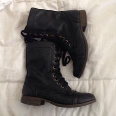 Super cute black combat boots in great condition! Tag says size 6.5 but I wear a size 7 in all other shoes and they fit me perfectly.