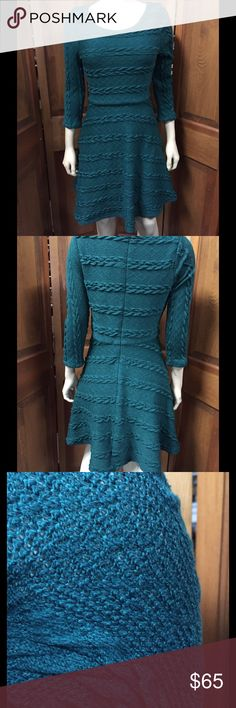 Teal textured Cable knit fit & flare sweater dress Item is partially lined with sleeves unlined the sleeves are also three-quarter length. This item has a back zipper. Item has partial stretch. 96% acrylic, 4% spandex – hundred percent polyester lining. This item is in great condition alya Dresses