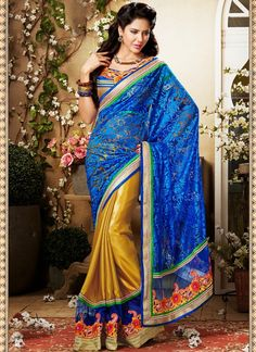 Elegance And Honourable Come Together In This Beautiful Drape.  Look Sensationally Awesome In This Blue & Gold Color Satin Saree.  It Has Been Beautifully Designed With Kasab, Resham & Stones Work.