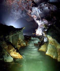 A British caver wades through Vietnam's Son Doong cave, Earth's largest known cave passage, according to a survey team.