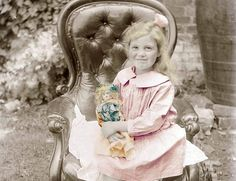 Little Blond Girl w Her doll Sits in Chair fine art by maclancy