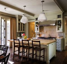 Love the back splash!  How about that wood island, too??  Michael S Smith kitchen