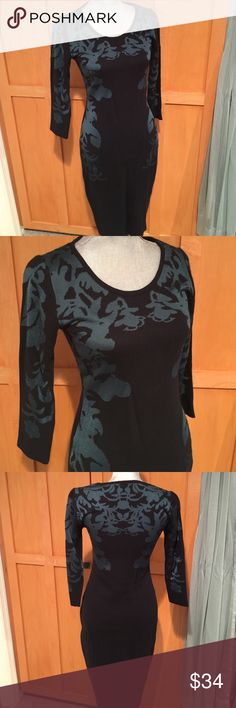"Bar III Knit Dress Bar III knit midi dress. Black with shimmery green print, 44% cotton, 38% rayon, 18% nylon. The tag says L but I had it altered to about a S. Length 42"", waist 29"", bust 32"". This dress is in excellent condition & beautiful on! Bar III Dresses Midi"