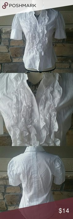 """Ruffle Front White Blouse Pretty and professional! Short sleeved white button down shirt with feminine ruffle front styling. By Moda International (through Victoria's Secret). Gently used, in very good condition. 100% cotton. 36"""" bust. Moda International Tops"""