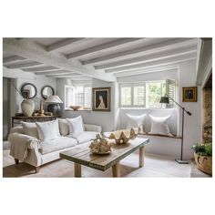 This beamed cottage has been modernised with new floors and a fresh neutral colour palette. To add more modernity to the space, they have also painted the beams to avoid the heavy-ceilinged feel you can sometimes get in an old cottage. Image: Anton & K. Rustic Home Interiors, Cottage Interiors, French Interiors, Cotswold Cottage Interior, Cottage Living Rooms, Living Room Decor, Cottage Homes, White Beams, White Wood
