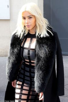 The root of it all: On Saturday Kim spent almost three hours getting her blonde hair touched up at a hair salon in Paris