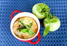 Mini Cocotte (red) with Spoon of baked eggs with herbed goat cheese