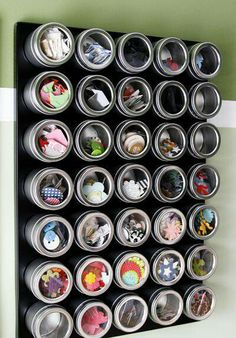 magnetic spice jars for small craft items like beads - available $8 for 3 at ikea or $6 for 3 at The Container Store or $10 for 5 at World Market.  Screw a cookie sheet or piece of sheet metal to wall to act as magnetic surface.  Would also work well for sewing supplies like bobbins and pins.