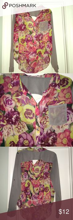 High low floral top with back cut out  Like new maybe worn once or twice, you can roll up the sleeves or wear them down. This has an open back design and is semi sheer! Super cute for work or play  Love Fire Tops Blouses