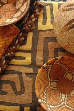 African Kuba cloth and baskets. Using the leaf of the raffia tree, the Kuba people of the Congo first hand cut, and then weave the strips of leaf to make pieces of fabric, often called raffia cloth.