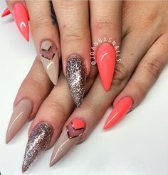 Nude and orange stiletto nails with glitter accent