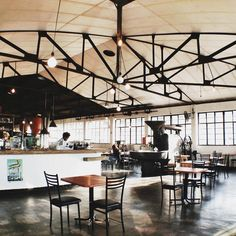 The Factory Cafe in Durban - beautiful industrial floors and metal work. High ceilings and open space. Cafe Restaurant, Restaurant Design, Restaurant Interiors, Cafe Interior, Interior Design, Waterfall House, Industrial Flooring, Meditation Space, Dark Interiors
