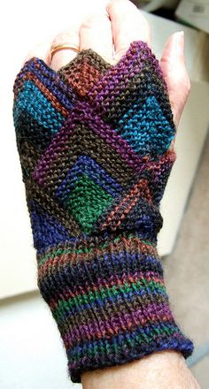 Domino back Awesome fingerless gloves! No pattern, but shouldn't be to difficult to figure out. History of Knitting Wool rotating, w. Crochet Mittens, Crochet Gloves, Knit Or Crochet, Knitting Yarn, Hand Knitting, Knitting Patterns, Fingerless Gloves Knitted, Knitted Hats, Wrist Warmers