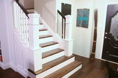 Black handrail with white newel post.