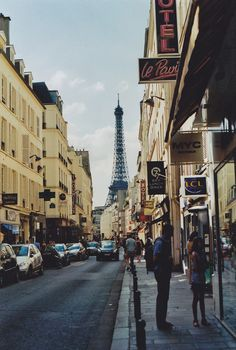 Paris Street: this photo reminds me of the morning we walked to the Eiffel Tower. Walking, walking, we couldn't see it above the tall buildings, until we turned a corner and there it was! I still remember the thrill of finally seeing it for real!