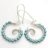 Learn how to make those chic sky-blue earrings step by step with wire and beads. The earring tutorial only requires basic wire wrapping and coiling technique.