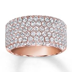 Five rows of round diamonds create breathtaking brilliance in this generous band for her. Additional rows fill the sides to complete the look. 2 carats total weight. Styled in 14K rose gold. Diamond Total Carat Weight may range from 1.95 - 2.11 carats.