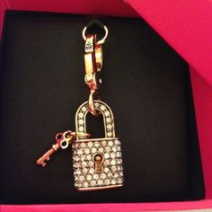 "NIB Juicy Coutour C-pave Padlock Charm sold out Juicy Coutour C-pave Padlock Charm ""Shining & Pretty"", sold out everywhere. From my personal collection. Brand new in box. Hate to let it go, but I have too many stuff. Need to make some room for my new collections. Welcome to bundle or make reasonable offers! Juicy Couture Jewelry"