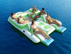 """The Tropical Tahiti Island from Sun Pleasure is a versatile and large inflatable raft for the lake that allows people to lounge or party anywhere on the float! Grab a regular seat or lay back on the two loungers. Either way don't forget some drinks because there is two built-in ice chests into this island float!  Features  Dimensions: 180"""" x 109"""" x 30"""" inflated  Holds up to 6 people  2 contoured loungers  4 seats with mesh floor to keep feet cool  2 built-in drink coolers  6 built-in drink…"""