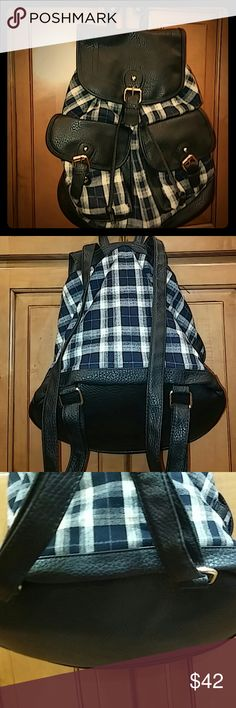 Francesca's Flannel faux leather backpack NWOT This is such a great functional backpack with 2 deep front pockets, inside zip wall & 2 slip pockets. Adjustable straps on back to wear on back or can be worn over shoulder. Fits so much including a 1in bookbinder, small tablet, notebooks, etc. Really versatile for trips also. Light weight flannel material in black, grey & ivory. Inside solid black material with gold hardware & snap close pockets, draw string close. New without tags. Excellent…