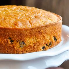 Here's a delicious taste of the Caribbean with a rum soaked raisins baked into a vanilla cake, then soaked in more rum. Enjoy it plain or dress it up with a caramel filling and rum buttercream frosting. Rock Recipes, Sweet Recipes, Rum And Raisin Cake, Just Desserts, Dessert Recipes, Raisin Recipes, Plain Cake, Caribbean Recipes, Caribbean Rum Cake
