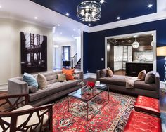 The traditional rug combined with the contemporary styling of the furniture creates such a designer look--! Looks like a crate & barrel chair in the forefront of the pic...