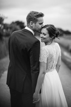 Shustoke Farm Barns wedding, Warwickshire, England. Lace buttoned back wedding dress: Phoebe Blockley Bridal -- Katie & Ross by D&A Photography, a Contemporary UK & Destination Wedding Photographer. #sleeves #wedding #dress #boho #bride
