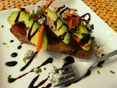 A Food Lover's Delight offers this Avocado Veggie Bleu Toast recipe as well as advice and discussion on all topics of delight to a food lover. Ripe Avocado, Avocado Toast, Mini Cucumbers, Mini Carrots, Butter Spread, Spicy Sausage, Banana Slice, Piece Of Bread, Whole Grain Bread