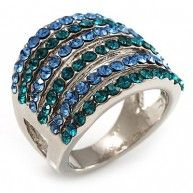 Bring a splash of vivid colour to any look with this Silver Tone Wide Crystal Band Ring.  Featuring a wide band design, crafted from sleek silver plated metal and decorated with alternated light blue ...