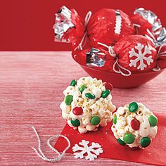 Popcorn Balls Ingredients: 16 cups popped popcorn  1 1/2 cups sugar  1 1/2 cups light corn syrup 2 teaspoons vinegar  2 teaspoons vanilla extract  4 tablespoons unsalted butter  1 cup red and green M&M's