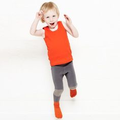 Atomic orange tights with orange socks and light grey knee patches for boys (& girls) by Little Titans * www.the-pippa-and-ike-show.com