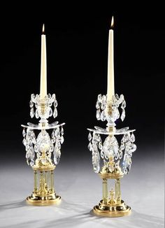 A PAIR OF GEORGE III CUT GLASS TEMPLE CANDLESTICKS - English, circa 1790